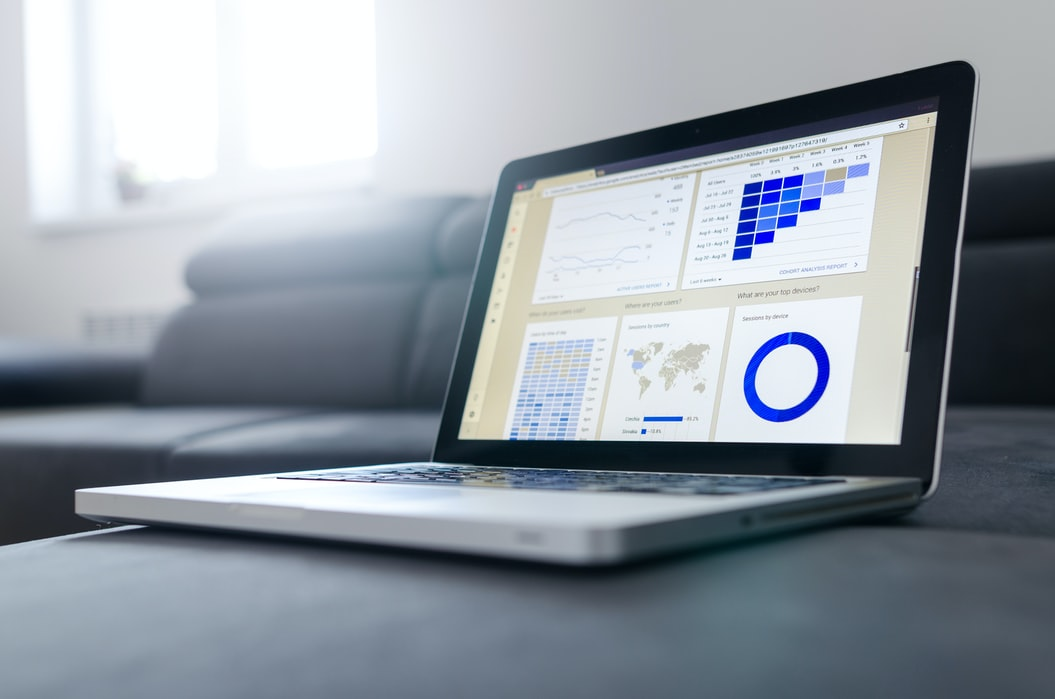 black-and-gray-laptop-with-graphs-and-maps